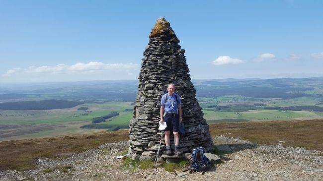 Gordon at the first summit Cromdales walk near Grantown-on-Spey