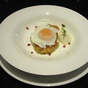 Perfectly poached egg on Bacon and Parsley Hotcake