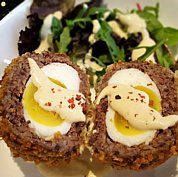 Our Scotch Egg with Black Pudding and Apple, served with mustard sauce